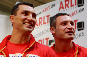 HAMBURG, GERMANY - JUNE 27:  Wladimir Klitschko (L) and and his brother Vitali attend a press conference on June 27, 2011 in Hamburg, Germany to preview the heavy weight title fight between Wladimir Kilitschko and David Haye which will be held on the 2nd