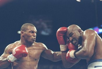 28 Jun 1997: Mike Tyson (L) lands a blow to the chin of Evander Holyfield during their bout against Mike Tyson at the MGM Grand Garden in Las Vegas, Nevada. Holyfield won the fight when referee Mills Lane disqualified Tyson in the third round after biting