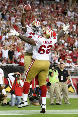 GLENDALE, AZ - SEPTEMBER 13:  Running back Frank Gore #21 of the San Francisco 49ers celebrates with teammate Chilo Rachal #62 after Gore scored a 3 yard touchdown reception against the Arizona Cardinals during the NFL game at the Universtity of Phoenix S