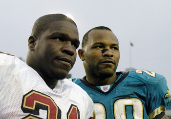 Jacksonville Jaguars running back Fred Jones (right) and San Francisco 49ers running back Frank Gore meet after play   December 18, 2005 in Jacksonville.    The Jaguars defeated the 49ers 10 - 9.  (Photo by Al Messerschmidt/Getty Images)