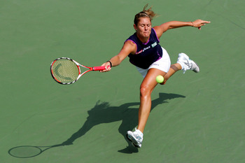 NEW YORK - AUGUST 30:  Julie Coin of France returns a shot against Amelie Mauresmo of France during Day 6 of the 2008 U.S. Open at the USTA Billie Jean King National Tennis Center on August 30, 2008 in the Flushing neighborhood of the Queens borough of Ne
