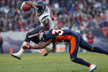 DENVER - DECEMBER 26:  Running back Arian Foster #23 of the Houston Texas rushes with the ball and is tackled by cornerback Perrish Cox #32 of the Denver Broncos at INVESCO Field at Mile High on December 26, 2010 in Denver, Colorado. The Broncos defeated