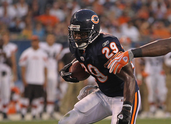 CHICAGO, IL - SEPTEMBER 01: Chester Taylor #29 of the Chicago Bears runs for yardage as Marcus Benard #58 of the Cleveland Browns closes in during a preseason game at Soldier Field on September 1, 2011 in Chicago, Illinois. (Photo by Jonathan Daniel/Getty