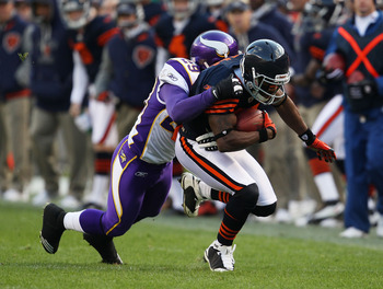CHICAGO - NOVEMBER 14: Rashied Davis #81 of the Chicago Bears is tackled by Lito Sheppard #29 of the Minnesota Vikings at Soldier Field on November 14, 2010 in Chicago, Illinois. The Bears defeated the Vikings 27-13. (Photo by Jonathan Daniel/Getty Images