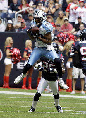 HOUSTON - NOVEMBER 28:  Wide receive Justin Gage #12 of the Tennessee Titans makes a catch in front of cornerback Kareem Jackson in the first quarter at Reliant Stadium on November 28, 2010 in Houston, Texas.  (Photo by Bob Levey/Getty Images)