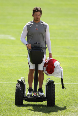 FLAGSTAFF, AZ - AUGUST 04:  Quarterback Kevin Kolb #4 of the Arizona Cardinals arrives to practice during the team training camp at Northern Arizona University on August 4, 2011 in Flagstaff, Arizona.  (Photo by Christian Petersen/Getty Images)