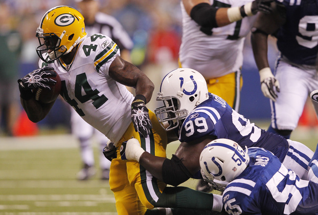INDIANAPOLIS, IN - AUGUST 26: Antonio Johnson #99 and Ernie Sims #55 of the Indianapolis Colts make a tackle on James Starks #44 of the Green Bay Packers during an NFL preseason game at Lucas Oil Stadium on August 26, 2011 in Indianapolis, Indiana. (Photo