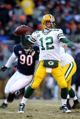 CHICAGO, IL - JANUARY 23:  Quarterback Aaron Rodgers #12 of the Green Bay Packers looks to pass against the Chicago Bears in the NFC Championship Game at Soldier Field on January 23, 2011 in Chicago, Illinois.  (Photo by Andy Lyons/Getty Images)