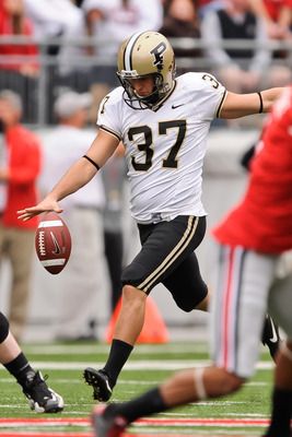 COLUMBUS, OH - OCTOBER 23:  Punter Carson Wiggs #37 of the Purdue Boilermakers punts against the Ohio State Buckeyes at Ohio Stadium on October 23, 2010 in Columbus, Ohio.  (Photo by Jamie Sabau/Getty Images)