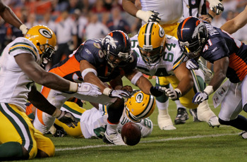 DENVER - AUGUST 22:  (L-R) Corey White #45 of the Packers, Josh Barrett #36 of the Broncos, Brennen Carvalho #63 of the Packer and Karl Paymah #41 of the Broncos pursue a loose ball in the endzone ruled down by contact after Kregg Lumpkin of the Green Bay
