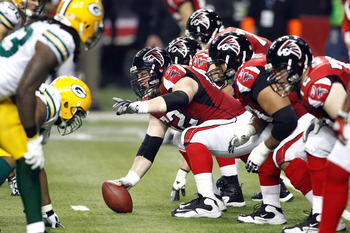 ATLANTA, GA - JANUARY 15:  Center Todd McClure #62 of the Atlanta Falcons readies the ball for the snap against the Green Bay Packers during their 2011 NFC divisional playoff game at Georgia Dome on January 15, 2011 in Atlanta, Georgia.  (Photo by Chris G
