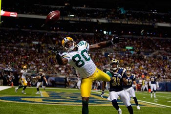ST. LOUIS, MO - SEPTEMBER 27:  Donald Driver #80 of the Green Bay Packers reaches for a pass in the endzone against Justin King #31 of the St. Louis Rams during the game at the Edward Jones Dome on September 27, 2009 in St. Louis, Missouri.  (Photo by Dil