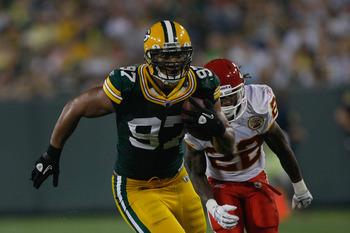 GREEN BAY, WI - SEPTEMBER 1: Vic So'oto #97 of the Green Bay Packers runs for a touchdown on an interception during a preseason game against the Kansas City Chiefs at Lambeau Field on September 1, 2011 in Green Bay, Wisconsin. (Photo by Scott Boehm/Getty