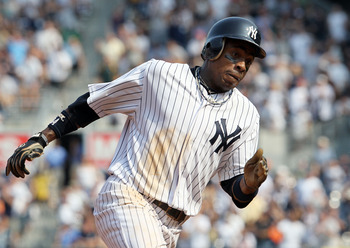 NEW YORK, NY - SEPTEMBER 03:  Curtis Granderson #14 of the New York Yankees heads for home to score a seventh inning run against the Toronto Blue Jays on September 3, 2011 at Yankee Stadium in the Bronx borough of New York City.  (Photo by Jim McIsaac/Get