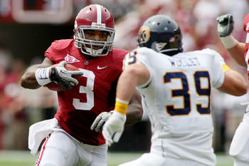 TUSCALOOSA, AL - SEPTEMBER 3:  Runningback Trent Richardson #3 of the Alabama Crimson Tide rushes up field during the first quarter as safety Luke Wollet #39 of the Kent State Golden Flashes defends on September 3, 2011 at Bryant Denny Stadium in Tuscaloo