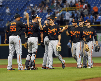 ST. PETERSBURG, FL - SEPTEMBER 02:  The Baltimore Orioles celebrate a 3-2 win against the Tampa Bay Rays on September 2, 2011 at Tropicana Field in St. Petersburg, Florida. (Photo by Al Messerschmidt/Getty Images)
