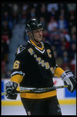 Center Mario Lemieux of the Pittsburgh Penguins looks on during a game against the Montreal Canadiens at the Montreal Forum in Montreal, Quebec.