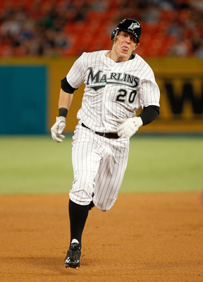 MIAMI GARDENS, FL - SEPTEMBER 02:  Logan Morrison #20 of the Florida Marlins heads to third base during a game against the Philadelphia Phillies at Sun Life Stadium on September 2, 2011 in Miami Gardens, Florida.  (Photo by Mike Ehrmann/Getty Images)