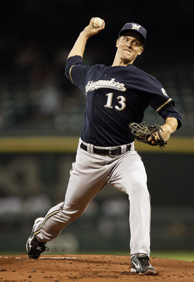 HOUSTON - SEPTEMBER 02:  Pitcher Zack Greinke #13 of the Milwaukee Brewers throws in the first inning against the Houston Astros at Minute Maid Park on September 2, 2011 in Houston, Texas.  (Photo by Bob Levey/Getty Images)