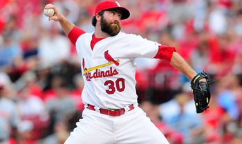 ST. LOUIS, MO - SEPTEMBER 3: Jason Motte #30 of the St. Louis Cardinals throws to a Cincinnati Reds batter at Busch Stadium on September 3, 2011 in St. Louis, Missouri.  (Photo by Jeff Curry/Getty Images)