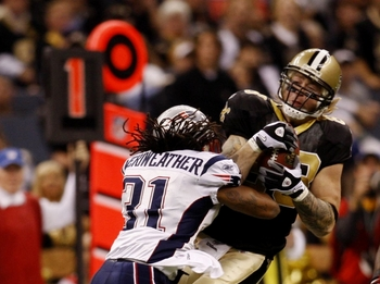 NEW ORLEANS - NOVEMBER 30: Jeremy Shockey #88 of the New Orleans Saints makes a catch for a first down in front of Brandon Meriweather #31 of the New England Patriots in the first quarter of the game at Louisana Superdome on November 30, 2009 in New Orlea
