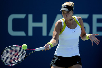 NEW YORK, NY - AUGUST 30:  Sabine Lisicki of Germany returns a shot against Alona Bondarenko of Ukraine during Day Two of the 2011 US Open at the USTA Billie Jean King National Tennis Center on August 30, 2011 in the Flushing neighborhood of the Queens bo