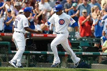 CHICAGO, IL - SEPTEMBER 2: Carlos Pena #22 of the Chicago Cubs is congratulated by Ivan DeJesus #11 as he runs the bases after hitting a home run during the game against the Pittsburgh Pirates at Wrigley Field on September 2, 2011 in Chicago, Illinois.  (