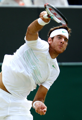 LONDON, ENGLAND - JUNE 25:  Juan Martin Del Potro of Argentina serves during his third round match against Gilles Simon of France on Day Six of the Wimbledon Lawn Tennis Championships at the All England Lawn Tennis and Croquet Club on June 25, 2011 in Lon