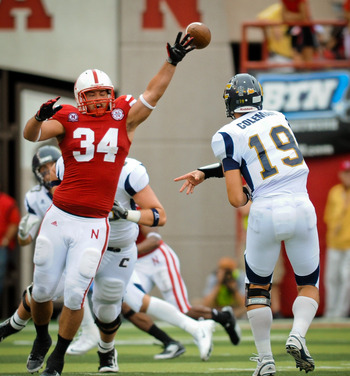 LINCOLN, NE - SEPTEMBER 3: Cameron Meredith #34 of the Nebraska Cornhuskers just misses a ball thrown my B.J. Coleman #19 of the Chattanooga Mocs during their game at Memorial Stadium September 3, 2011 in Lincoln, Nebraska. Nebraska won 40-7. (Photo by Er