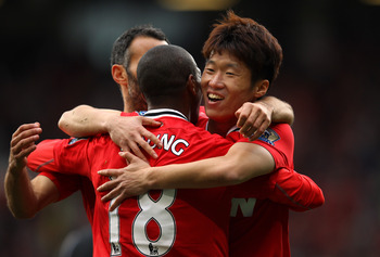 MANCHESTER, ENGLAND - AUGUST 28:  Ji-Sung Park of Manchester United celebrates with Ashley Young after scoring his goal during the Barclays Premier League match between Manchester United and Arsenal at Old Trafford on August 28, 2011 in Manchester, Englan