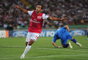 UDINE, ITALY - AUGUST 24:  Theo Walcott of Arsenal celerates his goal during the UEFA Champions League play-off second leg match between Udinese Calcio and Arsenal FC at the Stadio Friuli on August 24, 2011 in Udine, Italy.  (Photo by Jamie McDonald/Getty