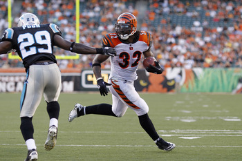 CINCINNATI, OH - AUGUST 25: Cedric Benson #32 of the Cincinnati Bengals runs for a 1-yard touchdown in the first half of an NFL preseason game against the Carolina Panthers at Paul Brown Stadium on August 25, 2011 in Cincinnati, Ohio. (Photo by Joe Robbin