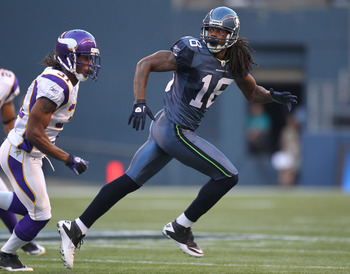 SEATTLE - AUGUST 20:  Wide receiver Sidney Rice #18 of the Seattle Seahawks runs a pass route against cornerback Chris Cook #31 of the Minnesota Vikings at CenturyLink Field on August 20, 2011 in Seattle, Washington. The Vikings won 20-7. (Photo by Otto G