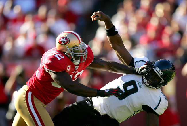 SAN FRANCISCO - NOVEMBER 29:  Patrick Willis #52 of the San Francisco 49ers hits David Garrard #9 of the Jacksonville Jaguars at Candlestick Park on November 29, 2009 in San Francisco, California.  (Photo by Ezra Shaw/Getty Images)