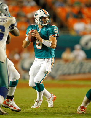 MIAMI GARDENS, FL - SEPTEMBER 01:   Pat Devlin #9 of the Miami Dolphins looks to pass during a Pre-Season NFL game against the Dallas Cowboys at Sun Life Stadium on September 1, 2011 in Miami Gardens, Florida.  (Photo by Mike Ehrmann/Getty Images)