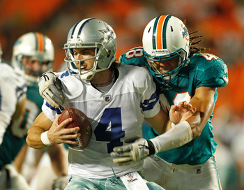 MIAMI GARDENS, FL - SEPTEMBER 01:   Tom Brandstater #4 of the Dallas Cowboys is sacked by  Quinton Spears #48 of the Miami Dolphins during a Pre-Season NFL game at Sun Life Stadium on September 1, 2011 in Miami Gardens, Florida.  (Photo by Mike Ehrmann/Ge