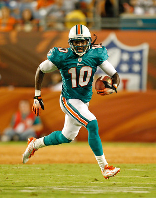 MIAMI GARDENS, FL - AUGUST 19:  Clyde Gates #10 of the Miami Dolphins runs with the ball during a Preseason NFL game against the Carolina Panthers at Sun Life Stadium on August 19, 2011 in Miami Gardens, Florida.  (Photo by Mike Ehrmann/Getty Images)