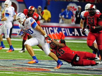 ATLANTA - SEPTEMBER 3: Kyle Efaw #80 of the Boise State Broncos runs with a catch against Christian Robinson #45 of the Georgia Bulldogs during the Chick-Fil-A Kickoff Game at the Georgia Dome on September 3, 2011 in Atlanta, Georgia. Photo by Scott Cunni