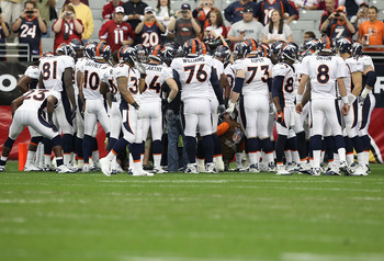GLENDALE, AZ - DECEMBER 12:  The Denver Broncos huddle up before the NFL game against the Arizona Cardinals at the University of Phoenix Stadium on December 12, 2010 in Glendale, Arizona.  (Photo by Christian Petersen/Getty Images)