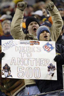 DENVER, CO - NOVEMBER 11:  Fans cheer on the Denver Broncos during Monday Night Football against the Oakland Raiders November 11, 2002 at Mile High Stadium in Denver, Colorado.  The Raiders won 34-10.  (Photo by Brian Bahr/Getty Images)