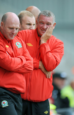 MORECAMBE, UNITED KINGDOM: - JULY 16: John Jensen (R) assistant manager of Blackburn Rovers during the pre season friendly match between Accrington Stanley and Blackburn Rovers at the Globe Arena on July 16, 2011 in Morecambe, England. (Photo by Clint Hug