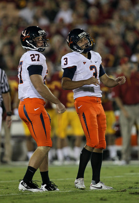 LOS ANGELES - SEPTEMBER 11:  Place kicker Robert Randolph #3 and holdler Jacob Hodges #27 of the Virginia Cavaliers react after missing a field goal attempt in the first quarter against the USC Trojans at Los Angeles Memorial Coliseum on September 11, 201