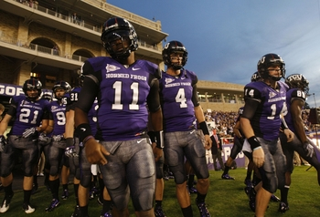 FORT WORTH, TX - NOVEMBER 14: Quarterbacks Marcus Jackson #11 and Casey Pachall #4 of the TCU Horned Frogs take the field before the game against the Utah Utes at Amon G. Carter Stadium on November 14, 2009 in Fort Worth, Texas.  (Photo by Ronald Martinez