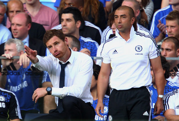 LONDON, ENGLAND - AUGUST 20:  (L-R) Andre Villas-Boas the Chelsea manager and his assistant coach Roberto di Matteo look on during the Barclays Premier League match between Chelsea and West Bromwich Albion at Stamford Bridge on August 20, 2011 in London,