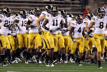 TEMPE, AZ - DECEMBER 28:  Jarrell Harrison #11 (C) of the Missouri Tigers runs onto the field with teammates before the Insight Bowl against the Iowa Hawkeyes at Sun Devil Stadium on December 28, 2010 in Tempe, Arizona.  (Photo by Christian Petersen/Getty