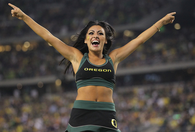 ARLINGTON, TX - SEPTEMBER 03:  A Oregon Ducks cheerleader at Cowboys Stadium on September 3, 2011 in Arlington, Texas.  (Photo by Ronald Martinez/Getty Images)