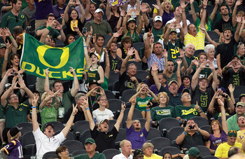 ARLINGTON, TX - SEPTEMBER 03:  Fans cheer before a game against the Oregon Ducks and the LSU Tigers at Cowboys Stadium on September 3, 2011 in Arlington, Texas.  (Photo by Ronald Martinez/Getty Images)
