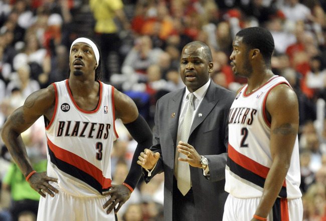 PORTLAND, OR - APRIL 28: (L to R) Gerald Wallace #3, head coach Nate McMillan and Wes Matthews #2 of the Portland Trail Blazers gather during a time out in the fourth quarter of Game Six of the Western Conference Quartefinals in the 2011 NBA Playsoffs on