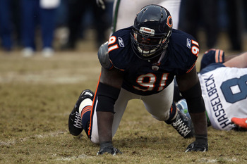 CHICAGO, IL - JANUARY 16:  Tommie Harris #91 of the Chicago Bears reacts after a sack of quarterback Matt Hasselbeck #8 of the Seattle Seahawks in the 2011 NFC divisional playoff game at Soldier Field on January 16, 2011 in Chicago, Illinois.  (Photo by J