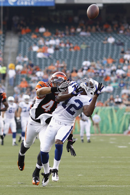 CINCINNATI, OH - SEPTEMBER 1: Taylor Mays #47 of the Cincinnati Bengals draws a pass interference call while defending a pass for David Gilreath #12 of the Indianapolis Colts in the first half of an NFL preseason game at Paul Brown Stadium on September 1,